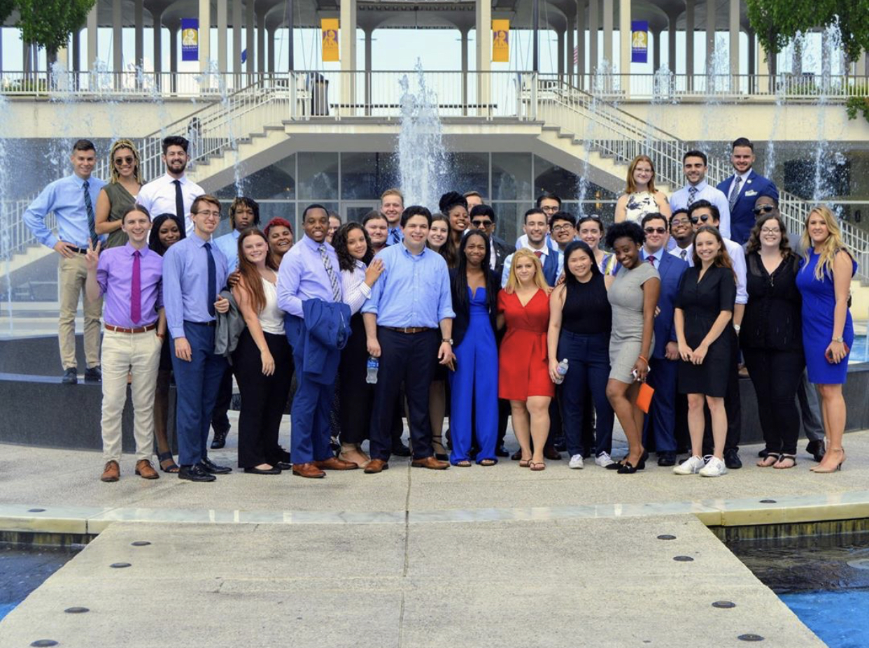 The SUNY SA Executive Committee standing in front of a fountain at the University at Albany