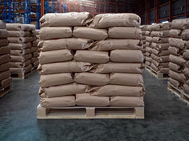 Brown sacks on wooden pallet store in in