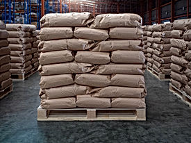 Brown sacks on wooden pallet store in in