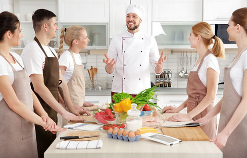 Male chef and group of people at cooking classes.jpg