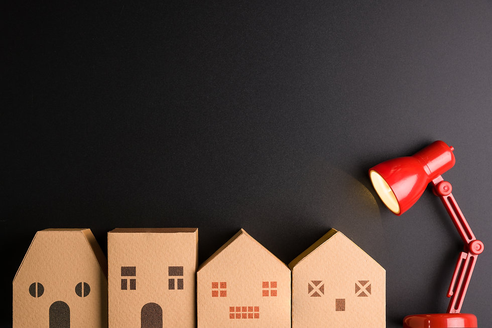 Paper house and Red lamp isolated on bla