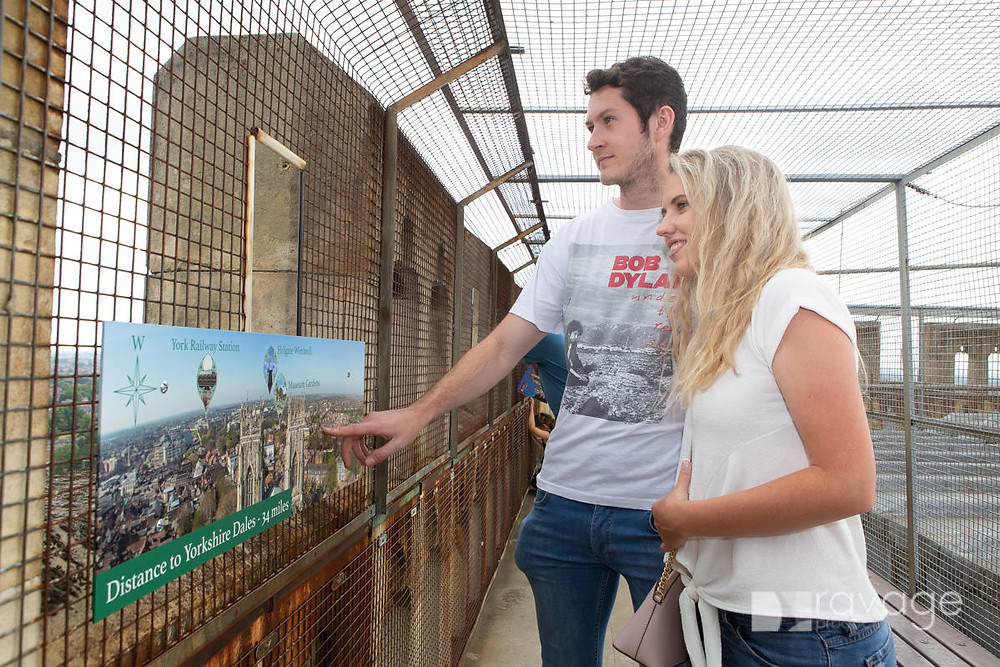 Visitors look at the Information board at the top of the tower at York Minster