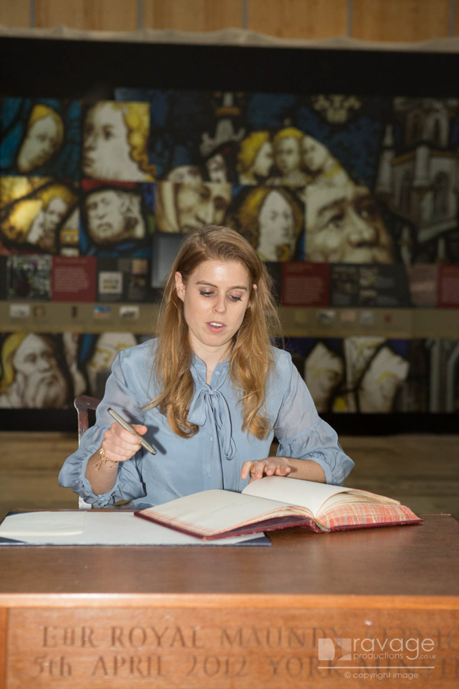 Princess Beatrice signs in