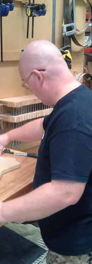 Templates are used to mark out new guitar bodies