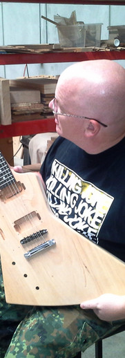 Checking over a guitar before painting