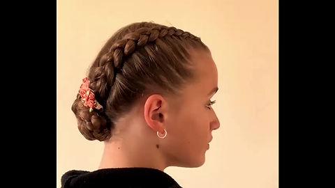 Katie showing how to do a Dutch braid bun