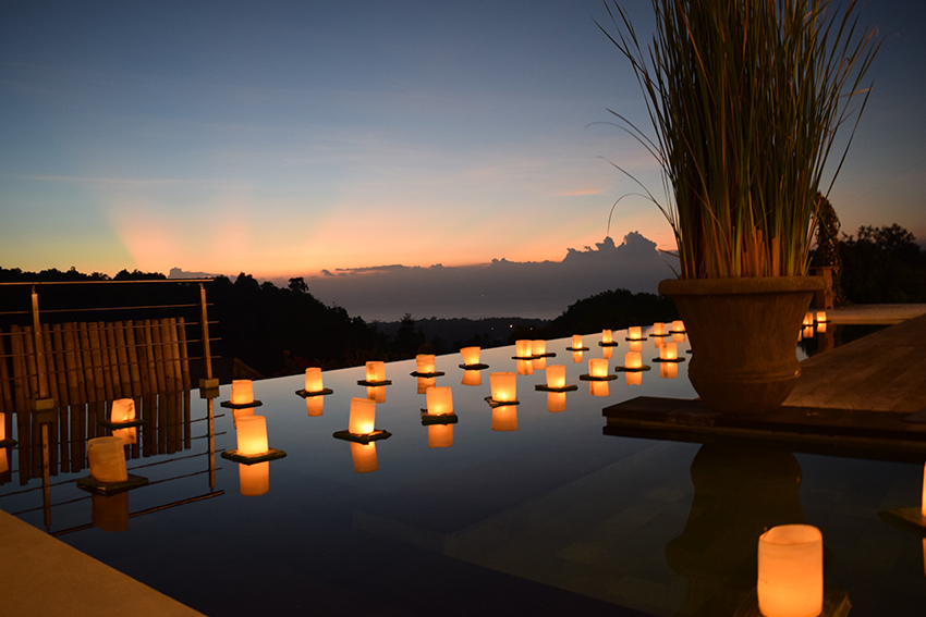 floating candles on pool