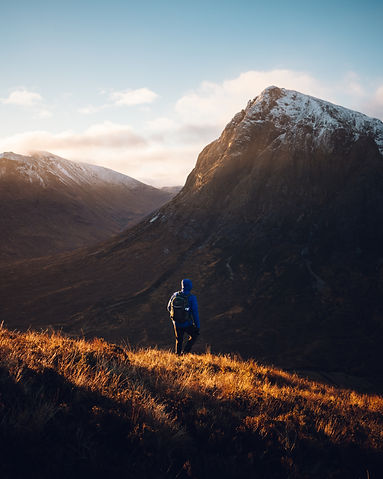 Hiking in the mountains of Scotlan at sunrise