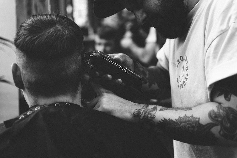 Detailed photograph of baber cutting a mans hair
