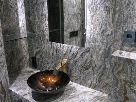 Granito en el baño con Onix: kosmus y Onix Negro.