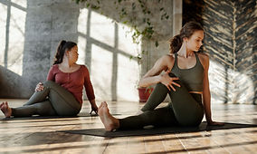 photo-of-women-stretching-together-40567
