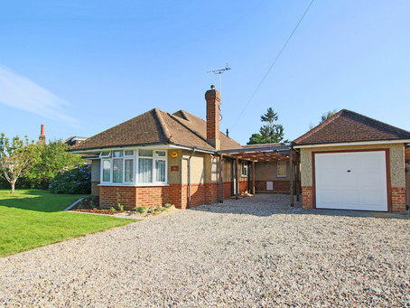 New: An extended and well-presented detached bungalow set in larger than average gardens with ...