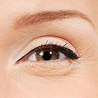 Fine lines and wrinkles including crows feet around the eye close-up