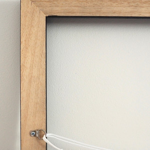 My wooden floater frames come with hanging attachments included, already fixed for you