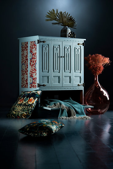 Pale blue painted carved cabinet with Ralph Lauren, red & blue floral fabricated panels, Perfect storage for drinks / bedding