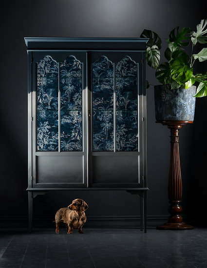 Tall restored drinks cabinet with glass panels and blue tones ombre up the front, produced in Windermere the Uk