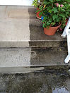 concrete step partially pressure washed