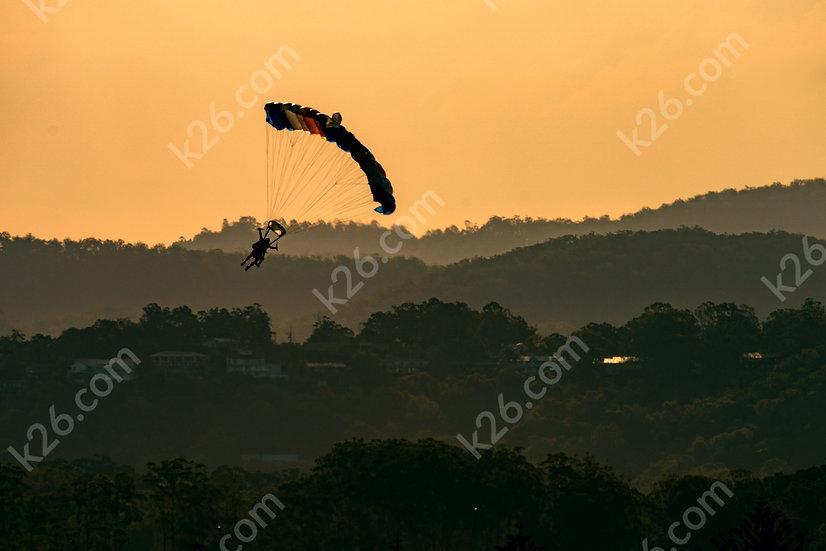 Parachutists land on Kirra Beach