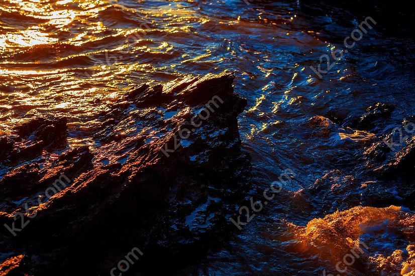 Waves break over the rocks at Currumbin
