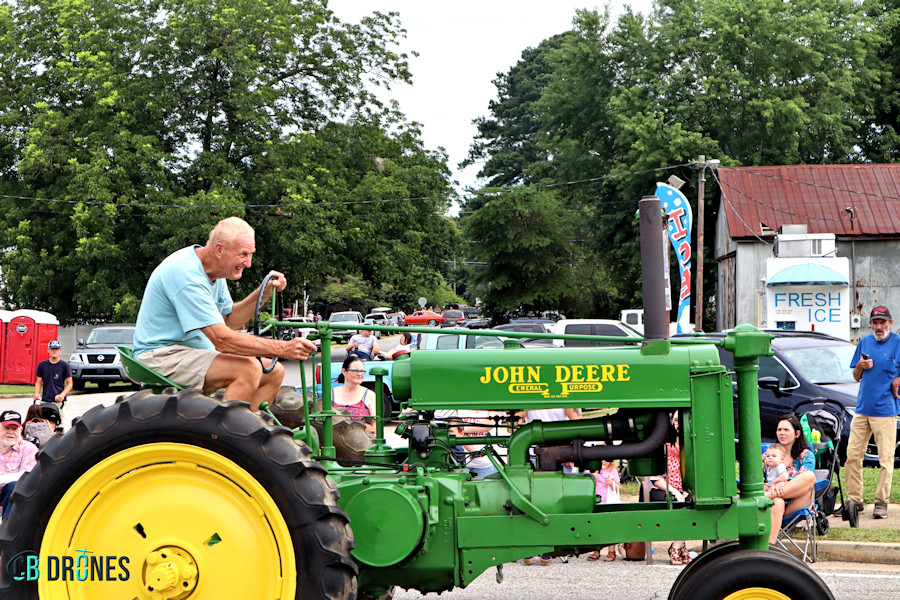 Man On Tractor Logo RS