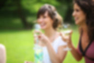 Women smiling outdoors wine.jpg