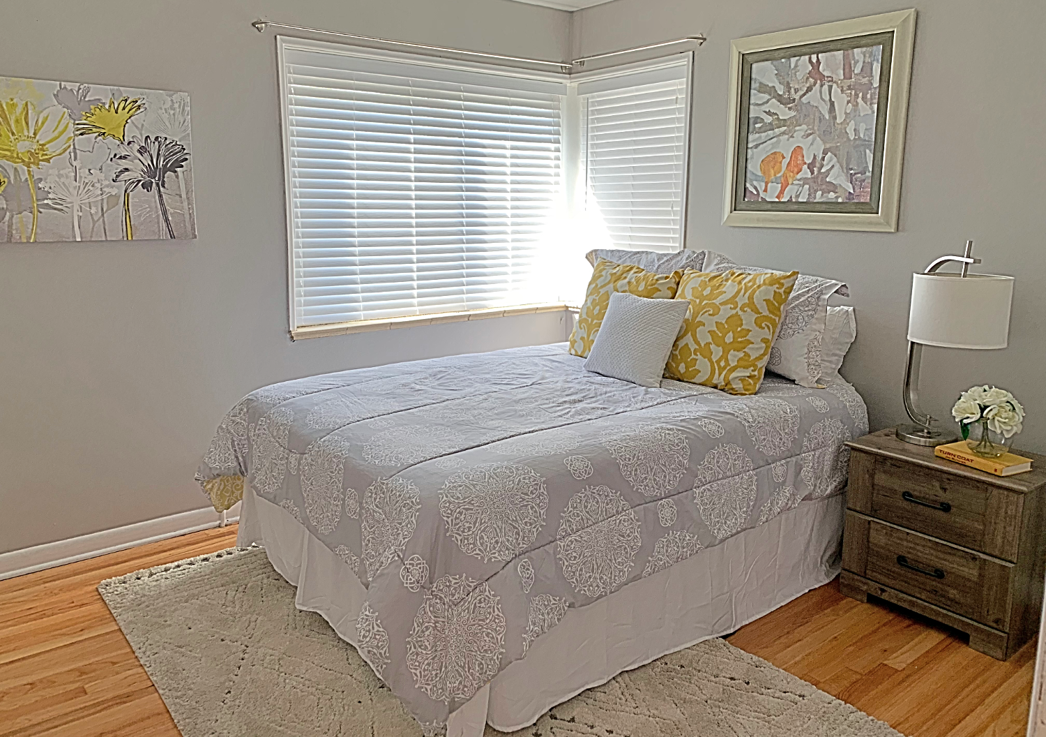 white, gray and yellow bedding