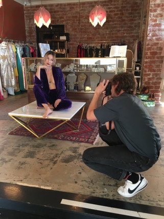 Photographer taking a picture of woman on table