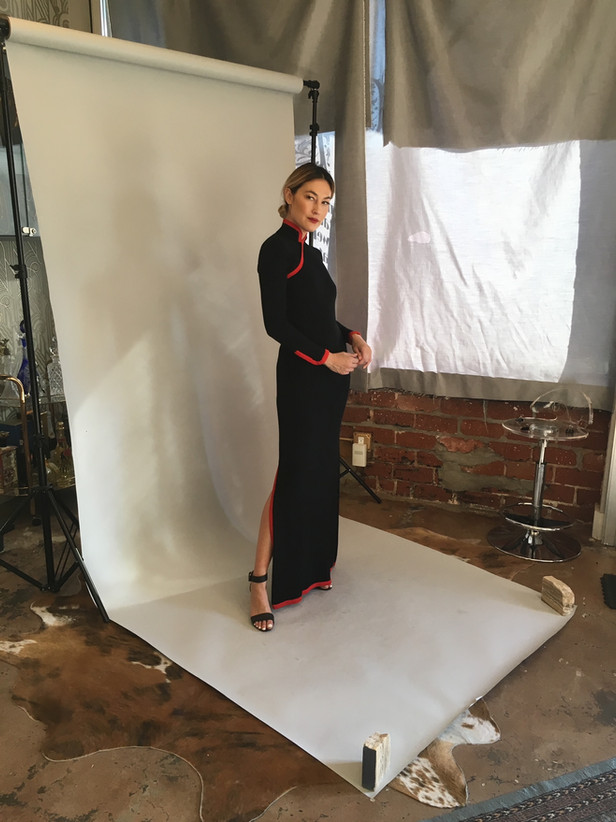 Woman Posing against backdrop