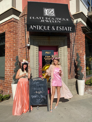 2 Woman posing in front of a store