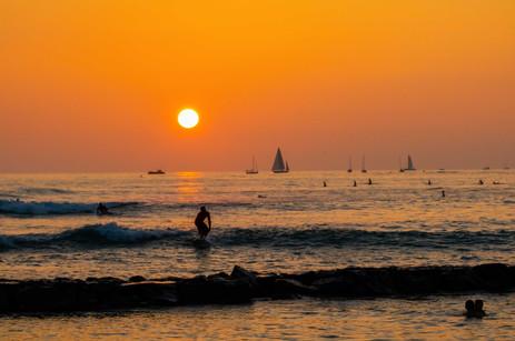 Sunset at Waikiki with surfers