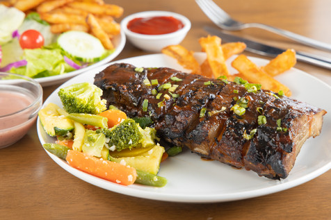 Bite Squad Food Photography.Baby Back Ribs (Half Rack) - Salad with