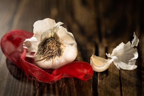 Raw Garlic on wooden table