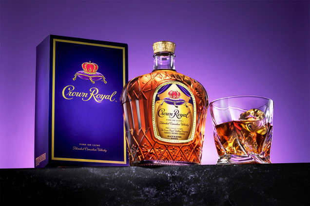 Crown Royal Whiskey on purple background