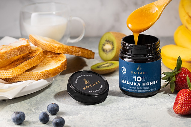 Manuka Honey and various fruits with bread and milk