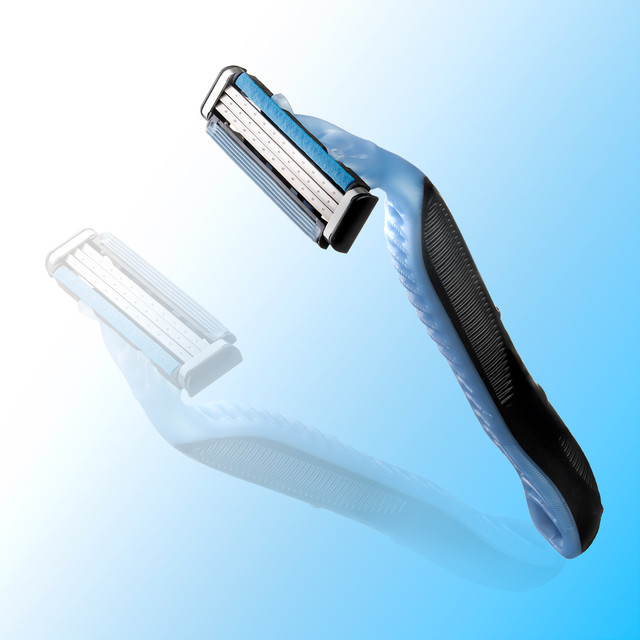 Razor with reflection on sky blue background, product photography, Hawaii