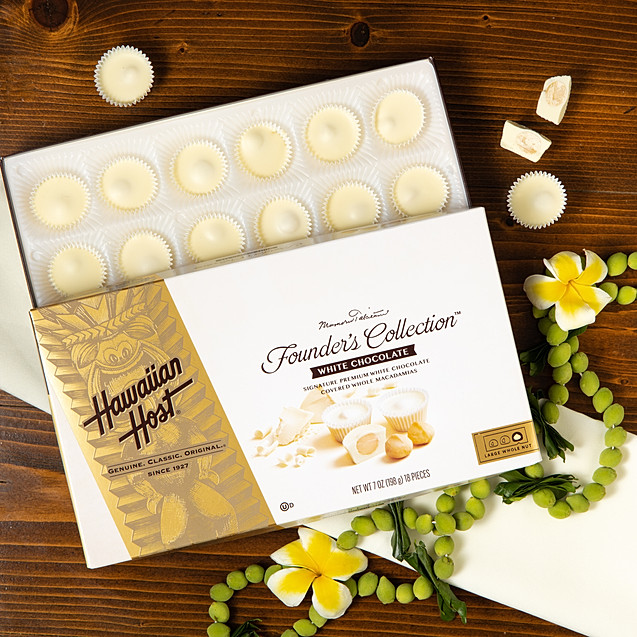 Hawaiian Host White chocolates with plumeria and green lei