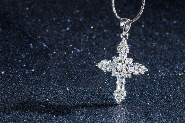 silver cross , creative hawaii jewelry photography