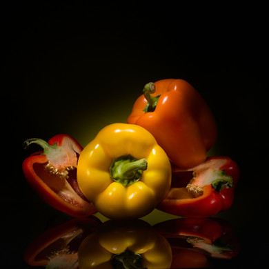 Sexy Colored Peppers in dark