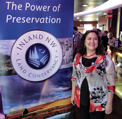 Vicki Egesdal with INLC banner