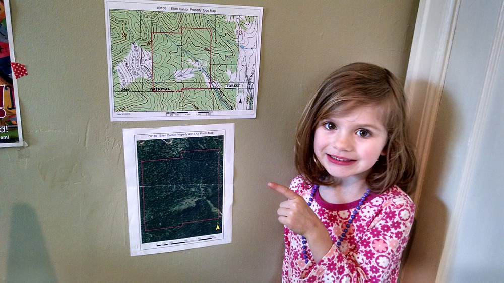 Granddaughter Nele proudly showing off maps