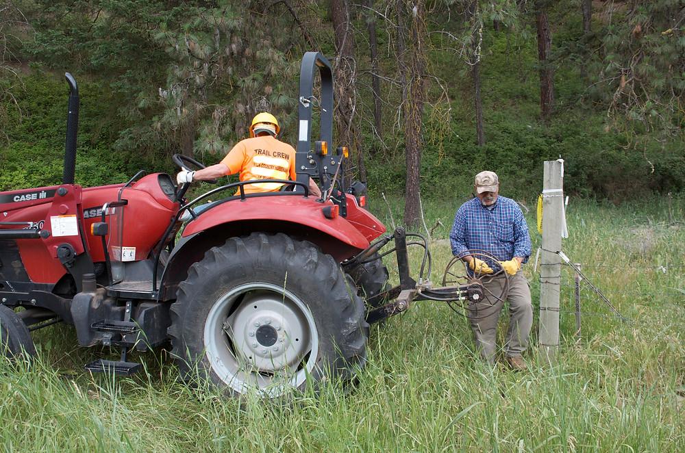 Volunteers pulling wire