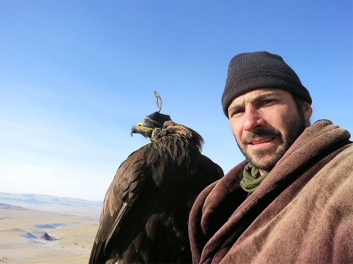 Hazen Audel with his hunting eagle - photo courtesy of Jo Sarsby Management
