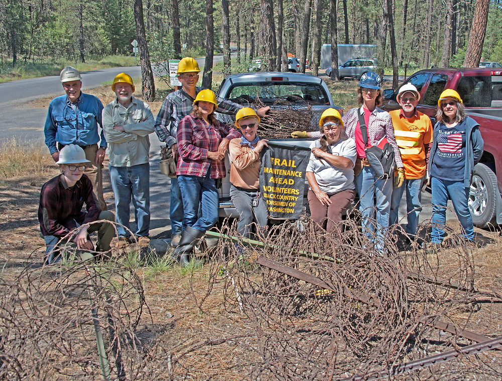 Group of volunteers who helped remove barbed wire