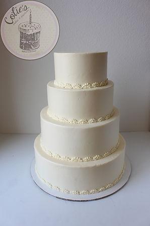 Fluffy white cake with all white vanilla buttercream