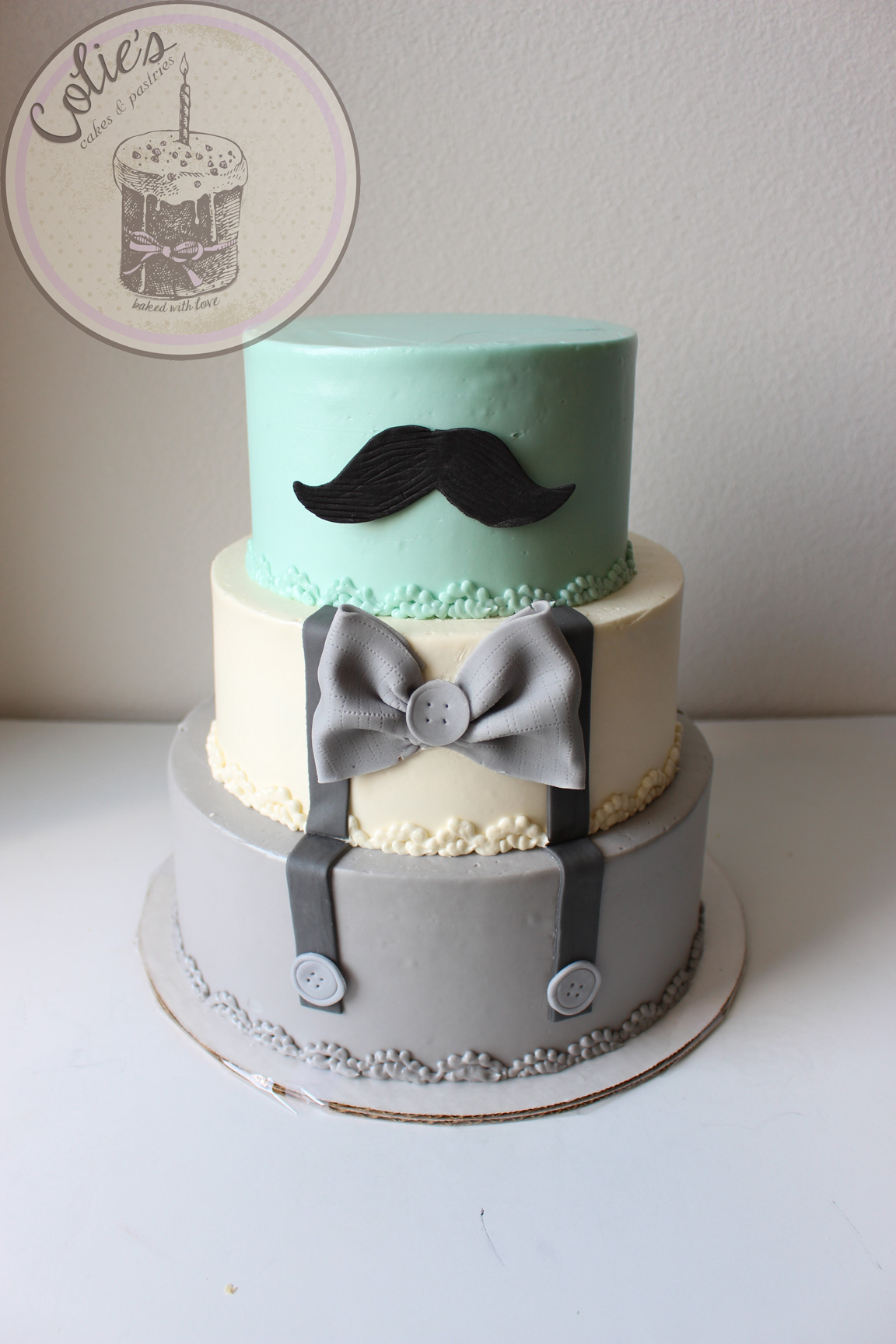 Mustache baby shower tiered cake