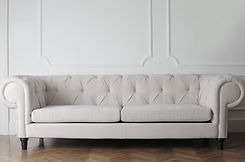 photo-of-white-couch-on-wooden-floor-375