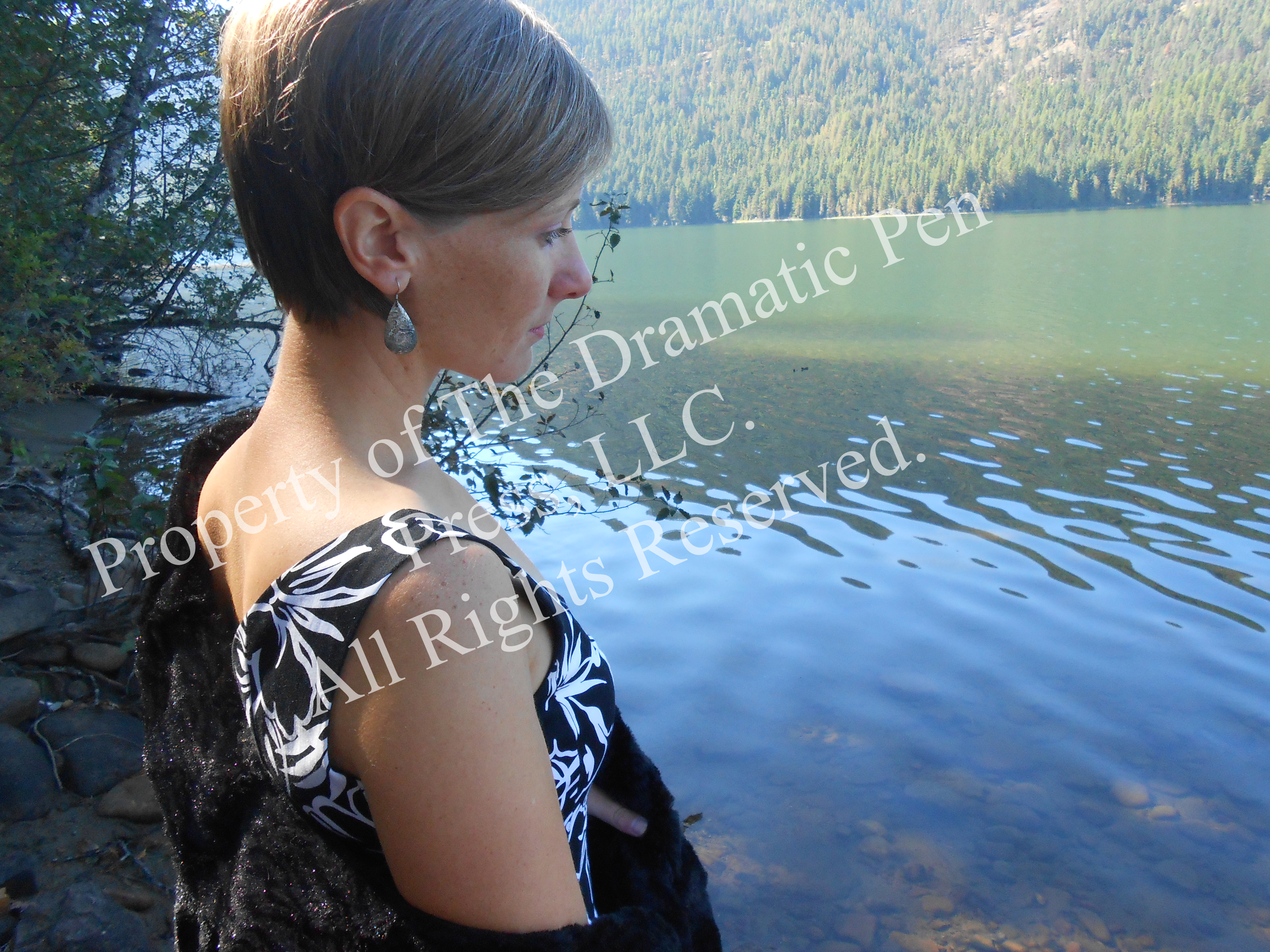 Contemplative Woman by Water