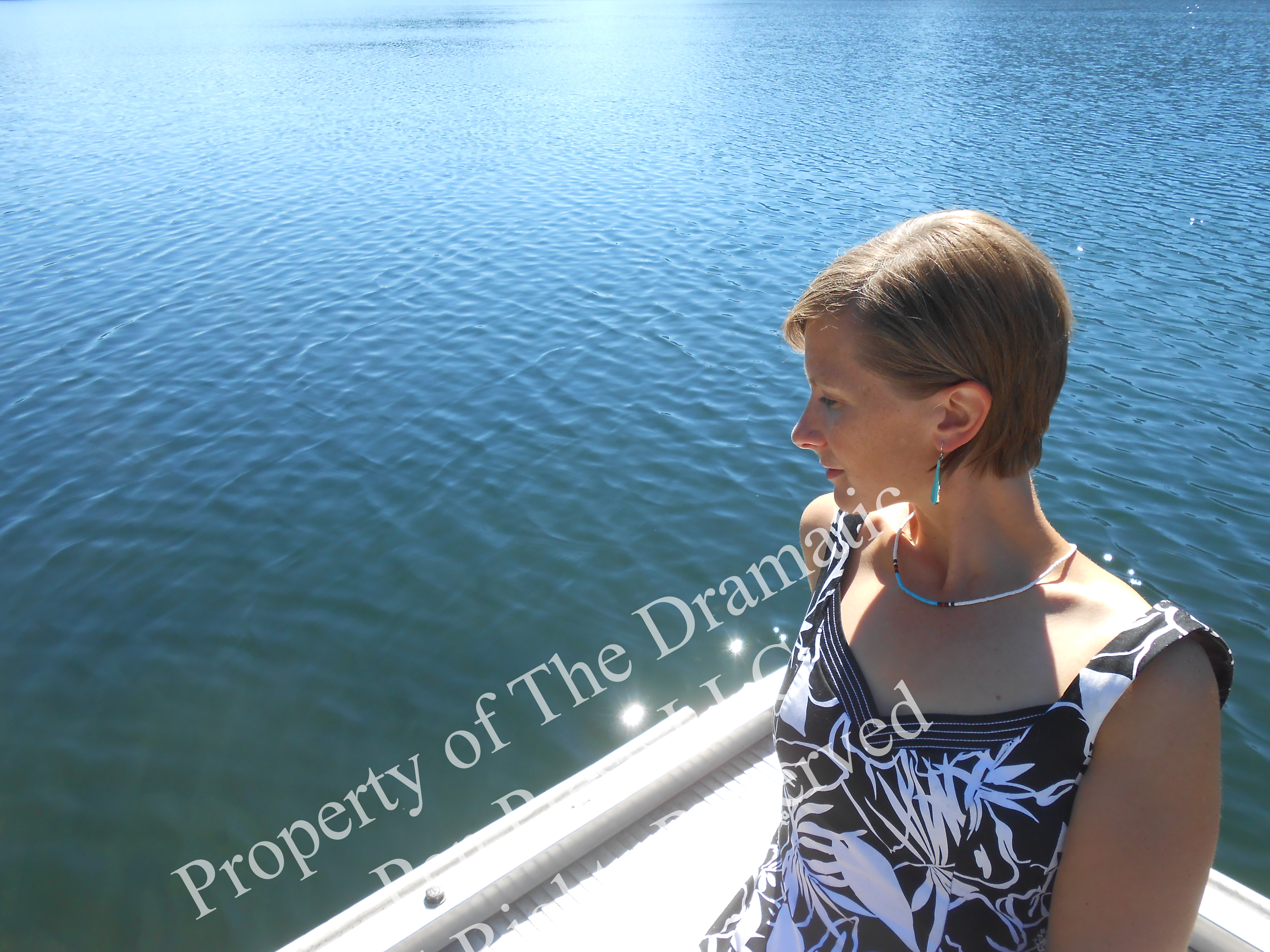 Woman on Dock Looking at Water