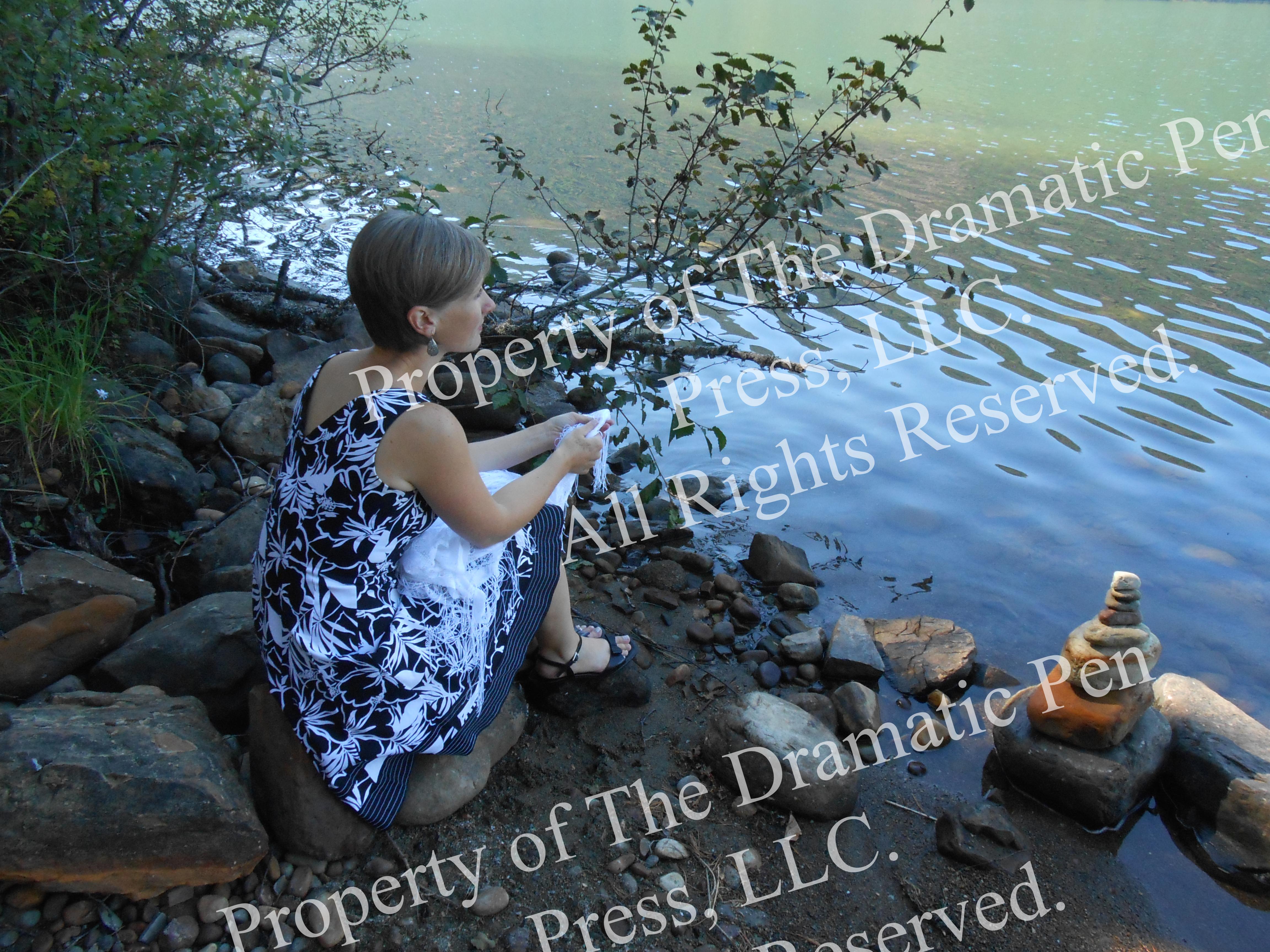 Woman on Shore Pretty Stones