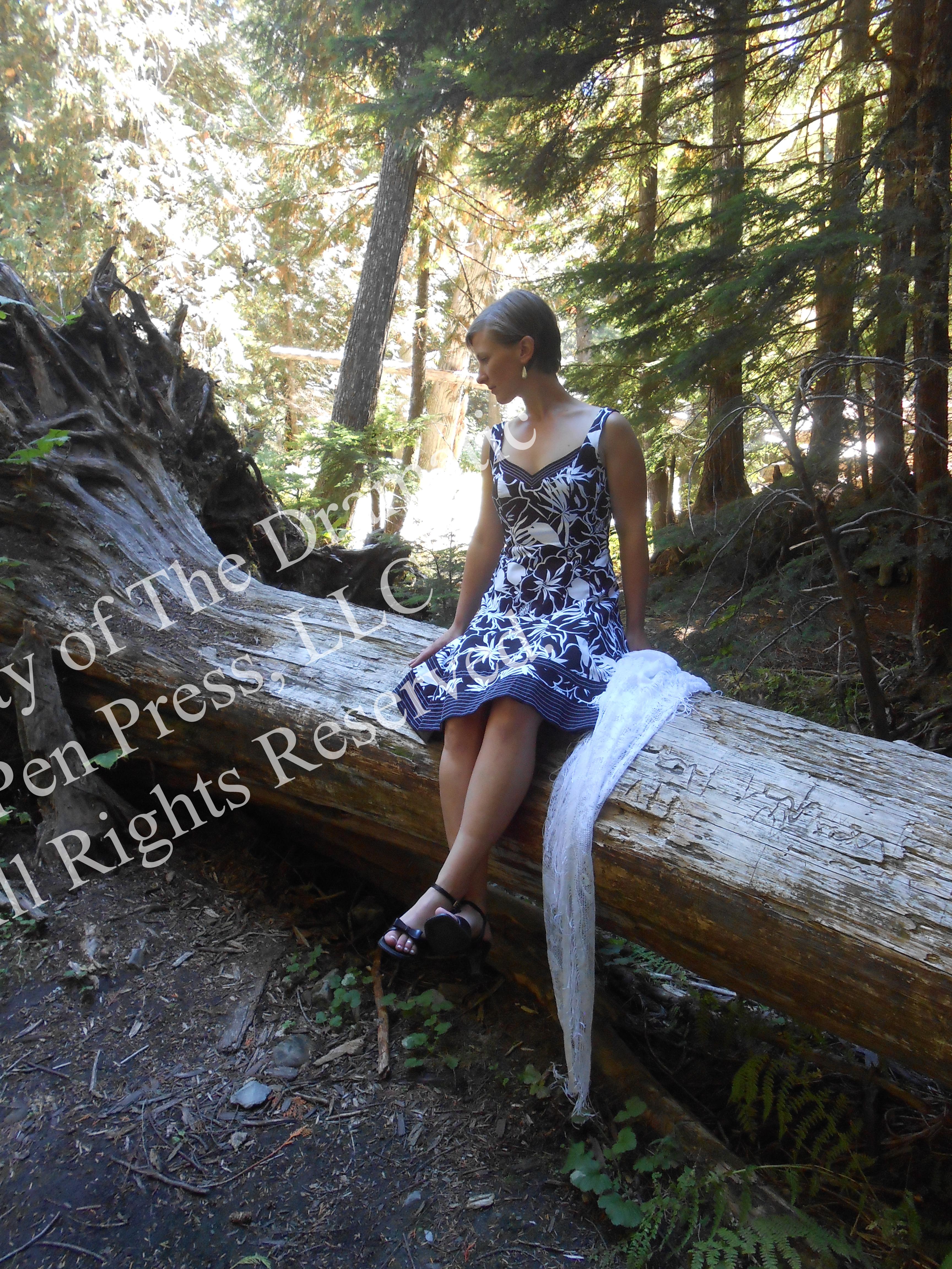Woman Sitting on Fallen Tree